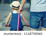 father is teaching his daughter ... | Shutterstock . vector #1118750060
