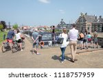 Small photo of NETHERLANDS - LEMMER - MAY 20, 2018: People are watching at the sluice in Lemmer in Holland.