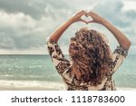 woman with beautiful curly hair ... | Shutterstock . vector #1118783600