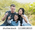 happy family having fun in the... | Shutterstock . vector #1118818010