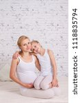 pregnant mother with her... | Shutterstock . vector #1118835794