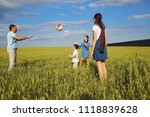 happy family playing with ball... | Shutterstock . vector #1118839628