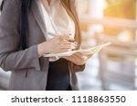 businesswomen hold calendars in ... | Shutterstock . vector #1118863550