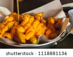 dish of cheese fries at cafe... | Shutterstock . vector #1118881136