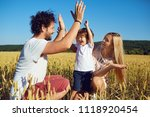 a happy family is enjoying fun... | Shutterstock . vector #1118920454