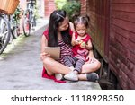 asian family activity holiday ... | Shutterstock . vector #1118928350