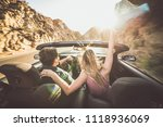 couple driving on a convertible ... | Shutterstock . vector #1118936069