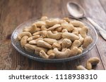 cashew nuts on a vintage or... | Shutterstock . vector #1118938310
