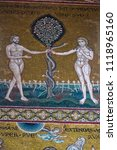 Small photo of Monreale, Palermo, Sicily, Italia - April 4, 2018: a detail of the Byzantine mosaic of the duomo.Adam and Eve with the Tree of Knowledge of Good and Evil in the garden of Eden
