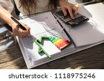 woman calculating invoice with... | Shutterstock . vector #1118975246
