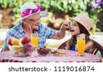 happy little girl and her... | Shutterstock . vector #1119016874