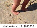 feet on the rocks | Shutterstock . vector #1119019256