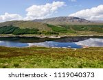 nice clouds reflection in a... | Shutterstock . vector #1119040373