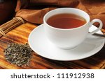 Stock photo a cup of whole leaf lapsang souchong tea a rich smoky flavored tea 111912938