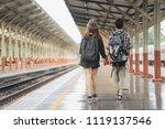 happy young couple on railway... | Shutterstock . vector #1119137546