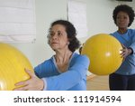 woman keeping exercise balls in ... | Shutterstock . vector #111914594