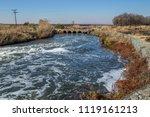 old low water concrete bridge... | Shutterstock . vector #1119161213