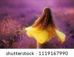 smiling girl sniffing flowers... | Shutterstock . vector #1119167990