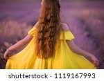 smiling girl sniffing flowers... | Shutterstock . vector #1119167993