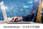 businessman typing on laptop...   Shutterstock . vector #1119172388