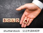 Realtor's Hand Puts A Cube Wit...