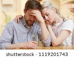 young troubled couple sitting... | Shutterstock . vector #1119201743