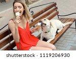 owner treating her yellow... | Shutterstock . vector #1119206930
