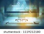 eyeglasses on office desk with...   Shutterstock . vector #1119212180