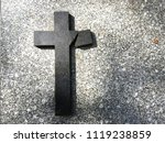 A Broken Cross On A Grave Of A...