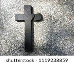 A Broken Cross On A Grave Of A...
