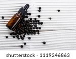 juniper essential oil on a... | Shutterstock . vector #1119246863