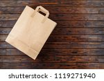 paper bag on a wooden background   Shutterstock . vector #1119271940