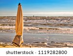 wind on closed sunshade in... | Shutterstock . vector #1119282800