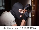 burglar wearing balaclava mask...
