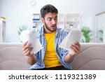man angry at bills he needs to... | Shutterstock . vector #1119321389