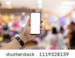 hand holding phone at blurred... | Shutterstock . vector #1119328139