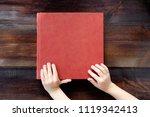 kid holding hands on brown... | Shutterstock . vector #1119342413