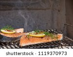 salmon on grill barbecue with... | Shutterstock . vector #1119370973