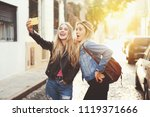 two beautiful girlfriends... | Shutterstock . vector #1119371666