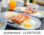 breakfast with hot dogs  fried... | Shutterstock . vector #1119374120