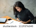 young woman sitting  working at ... | Shutterstock . vector #1119376340
