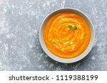 pumpkin cream soup on a gray... | Shutterstock . vector #1119388199