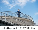 confident businessman stand on... | Shutterstock . vector #1119388406
