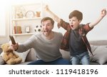 emotional father and son... | Shutterstock . vector #1119418196