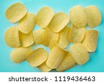 salted yellow chips on blue...   Shutterstock . vector #1119436463
