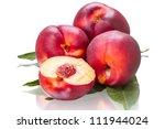 Four ripe nectarines isolated on white background - stock photo