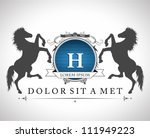 Stock vector vintage emblem with horses with a place for your text 111949223