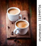two cups of espresso on rustic... | Shutterstock . vector #111949736