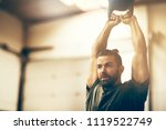 fit and focused young man in... | Shutterstock . vector #1119522749