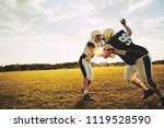 young american football players ... | Shutterstock . vector #1119528590